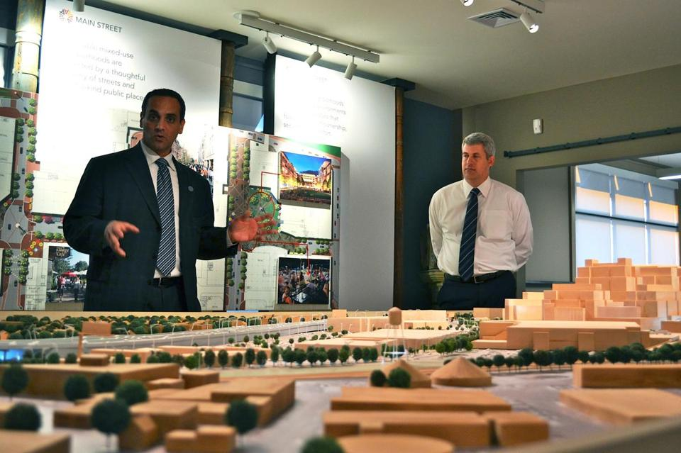 Mayor Joseph Curtatone (left), shown here in December 2012 with Federal Realty senior vice president Don Briggs, has been able to push through projects such as the multimillion-dollar Assembly Square redevelopment, seen in an architectural rendering above.