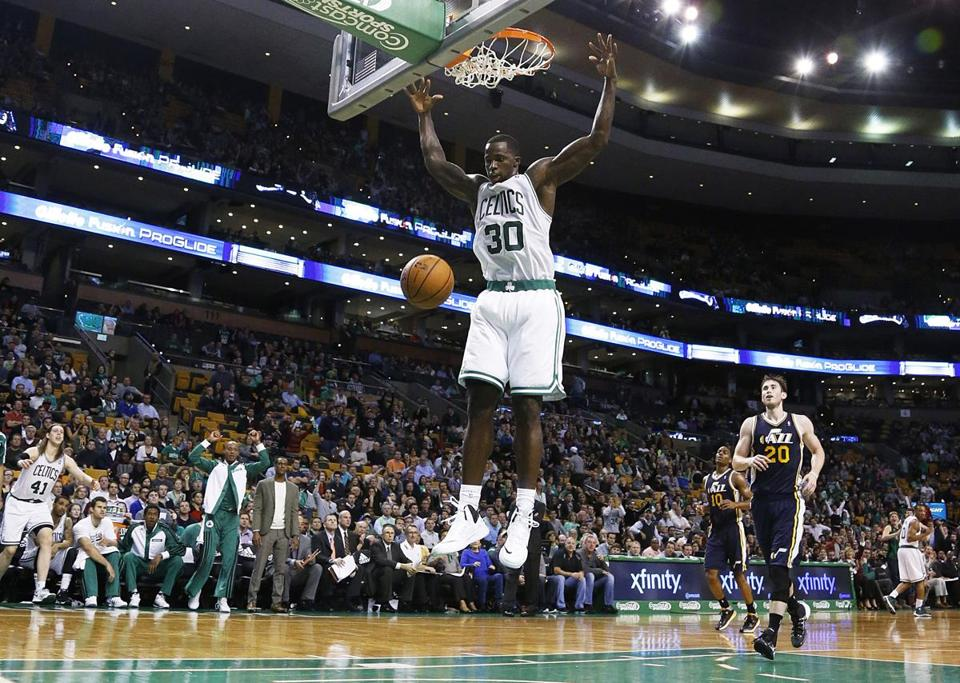 Celtics forward Brandon Bass slammed home two points late in the game to help seal the win.