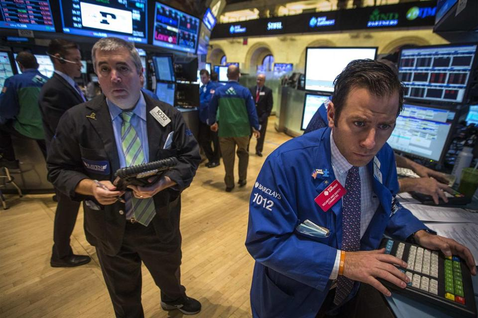 Traders worked on the floor of the New York Stock Exchange on Friday.