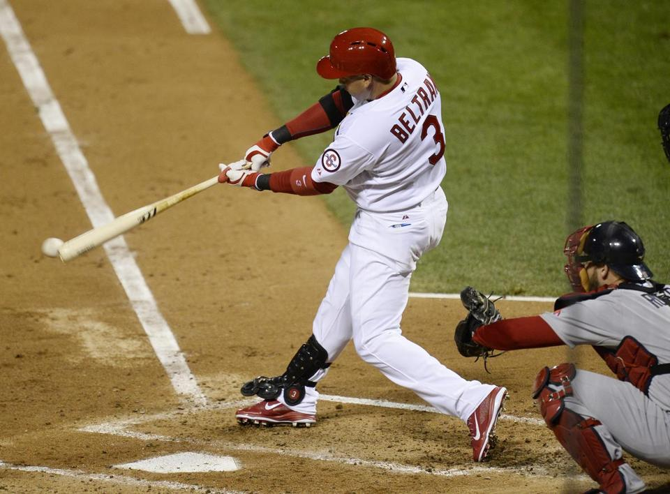 Carlos Beltran connects for an RBI single in Game 4 of the World Series. EPA/JOHN G. MABANGLO