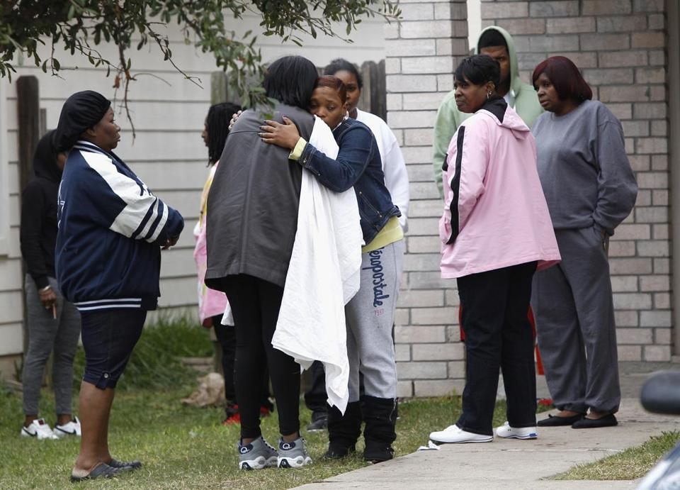 The shooting in suburban Houston left nearly two dozen people injured.