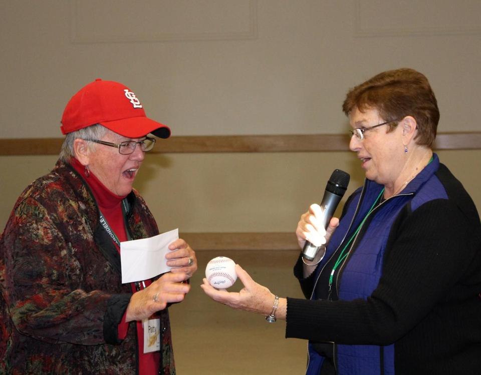 Sister Rosemary Brennan (right) of the Sisters of St. Joseph of Brighton presenting the Larry Lucchino-inscribed baseball to Sister Patty Clune of the Sisters of St. Joseph of St. Louis.