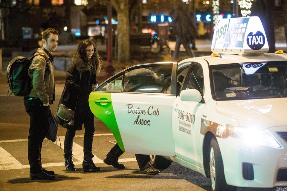 A cab waited at Faneuil Hall in Boston at 1:20 a.m., when no T service was available.