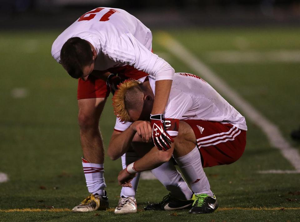 Silver Lake's Westen Dennett (12) comforts teammate Sean Hurlburt after their loss in the championship game.