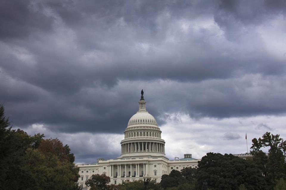 Dark clouds loomed over the US Capitol in Washington on Sept. 28, 2013.