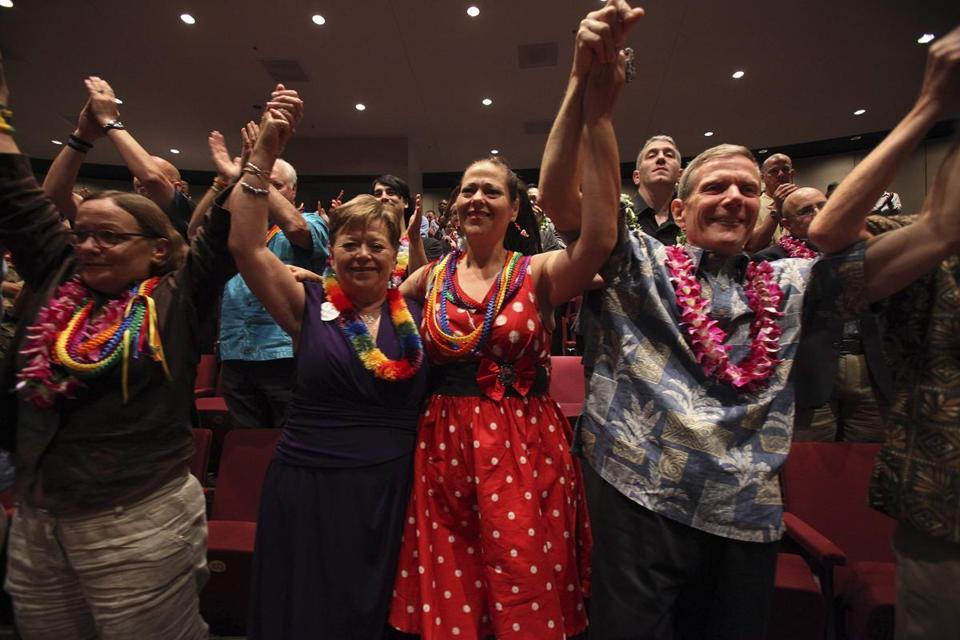 Supporters cheered after Hawaii's governor signed a bill legalizing gay marriage, making Hawaii the 15th state to do so.