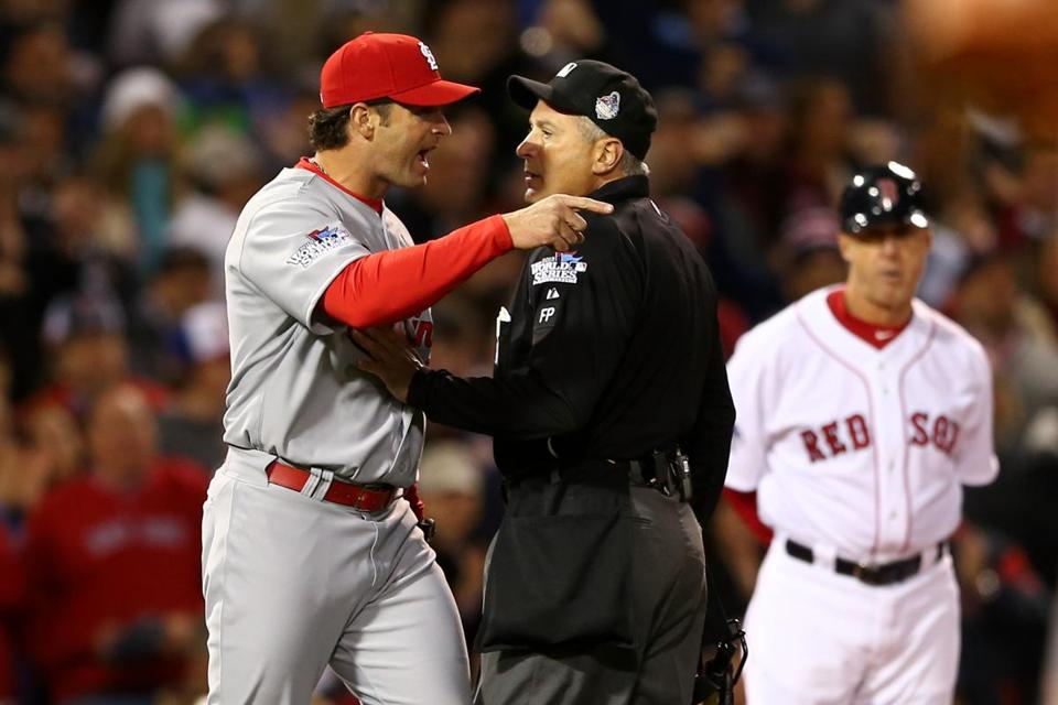 The manager-umpire argument in baseball may become a rare sight under new instant replay rules. . (Photo by Elsa/Getty Images)