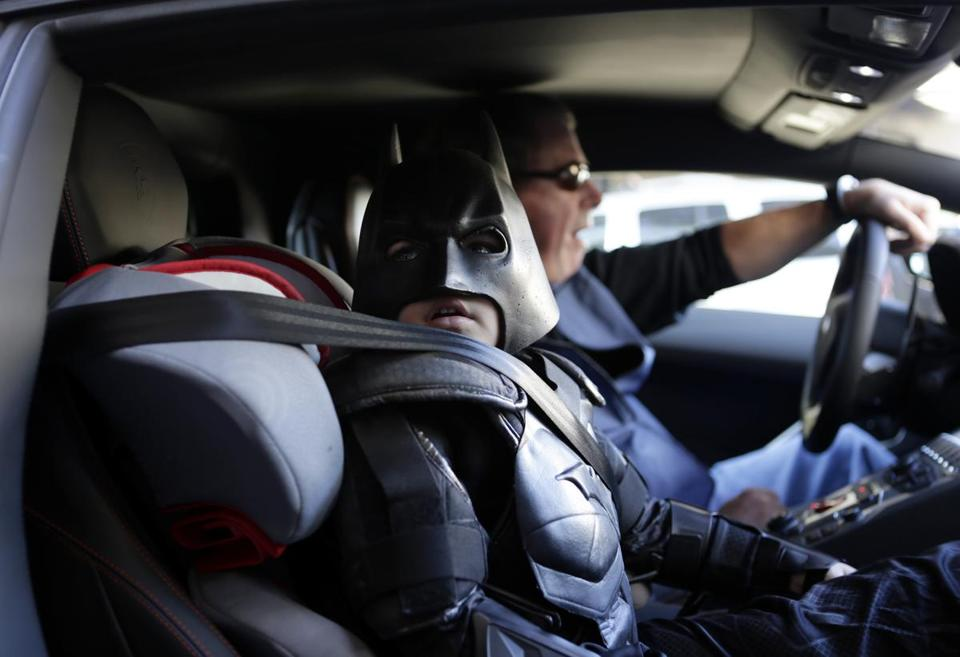 "Batkid, whose real identity is 5-year-old Miles Scott, waited in a Lamborghini ""Batmobile"" as he and Batman prepared to stop a bank robbery in San Francisco."
