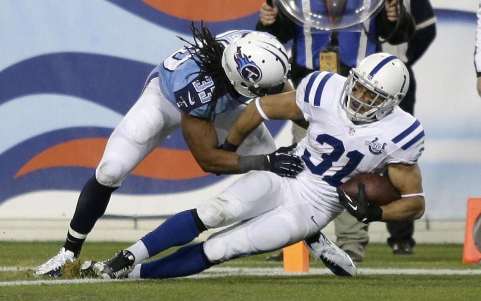 Colts running back Donald Brown eluded Titans safety Michael Griffin and scored a touchdown during the third quarter.