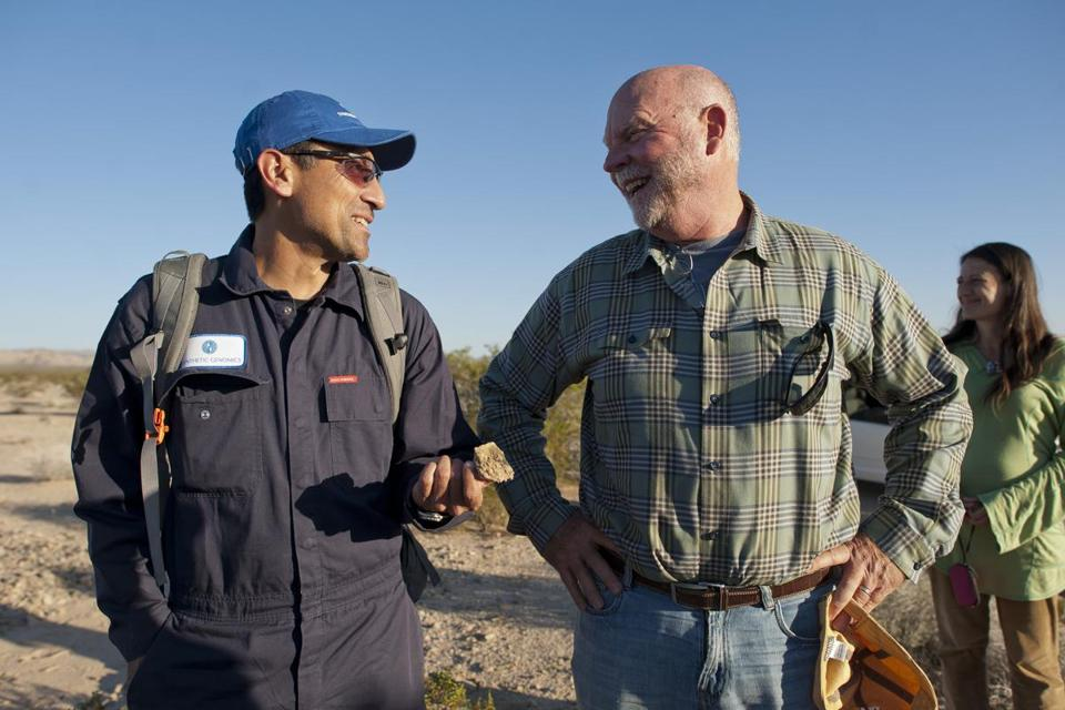 Gerardo Toledo (left), of Synthetic Genomics, spoke with J. Craig Venter in the desert outside Baker, Calif., site of an experiment involving biological data transmissions.