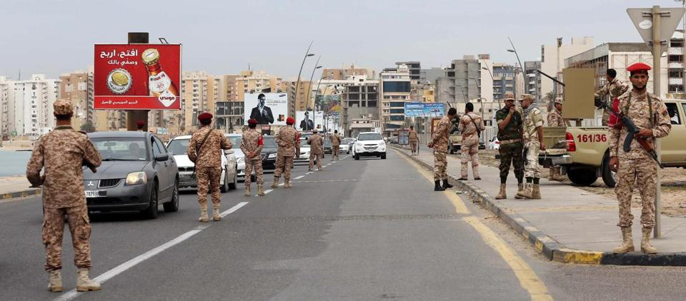 Libyan soldiers patrolled a street in Tripoli on Monday after militias were ordered to leave the capital following clashes during the weekend.