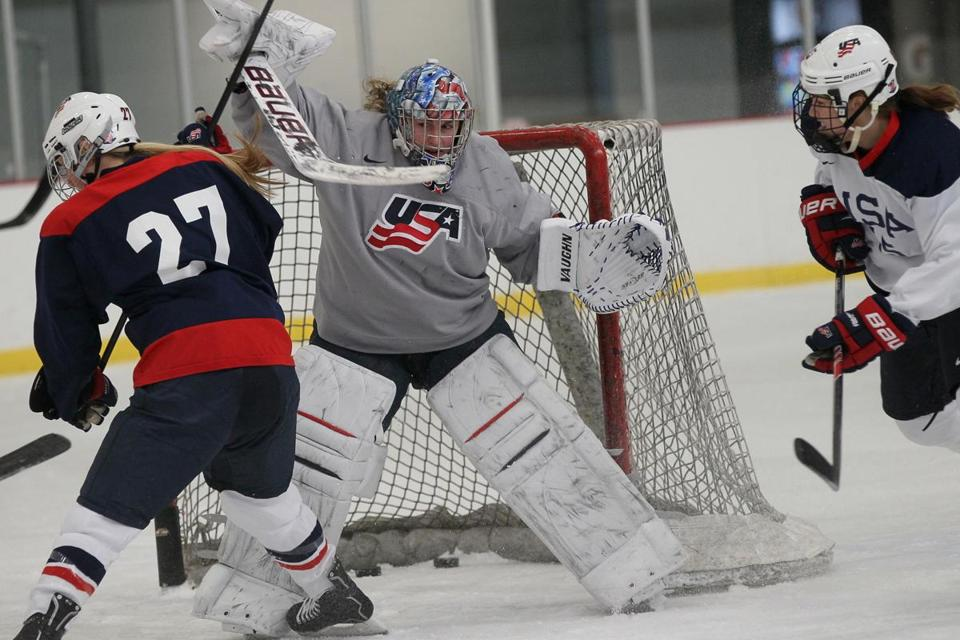 Goalie Jessie Vetter reacts to a shot by Annie Pankowski (27) during a US hockey team practice in Bedford.