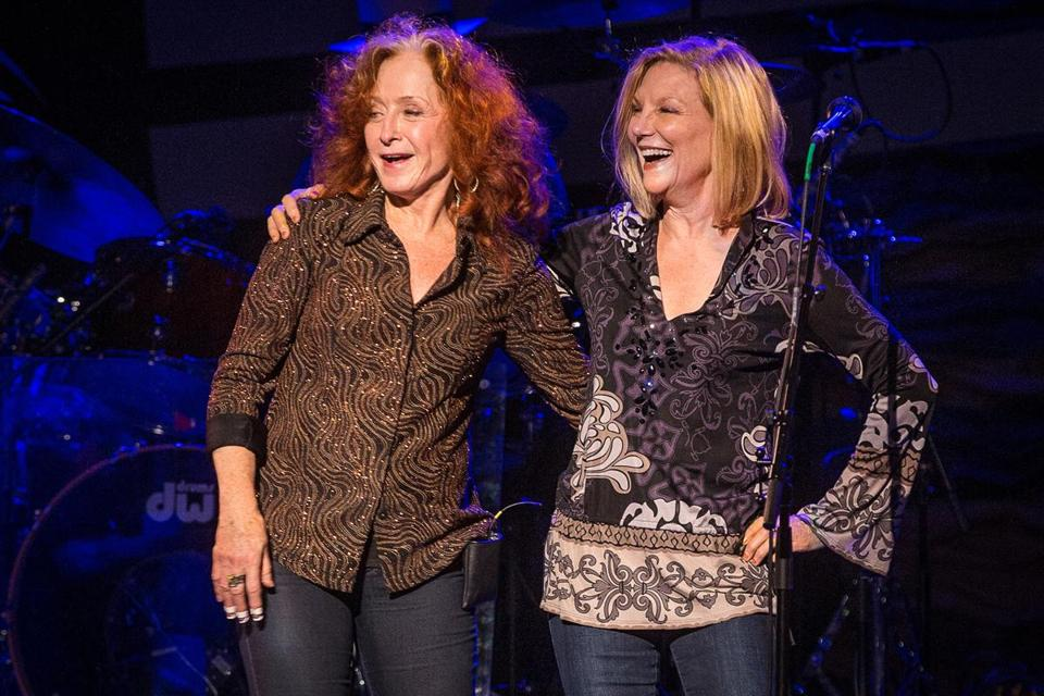 Bonnie Raitt (left) surprised the Orpheum's audience by inviting Bonnie Hayes, new on Berklee's faculty, on stage.