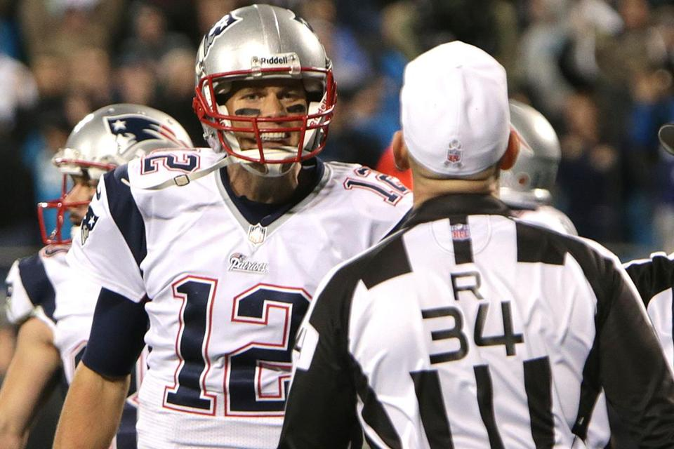 Flag picked up and game over, Tom Brady tries to state his case to referee Clete Blakeman.