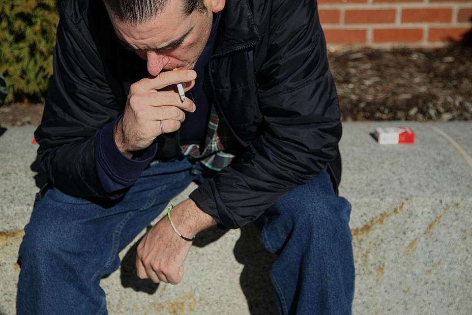 Mike took a moment for a quiet cigarette after the court released him from Worcester.