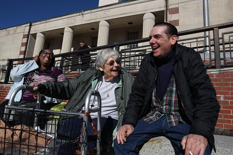 Mike relaxed in the sun with his grandmother Bernice and his girlfriend, Renee Johnson, after his release from Worcester.