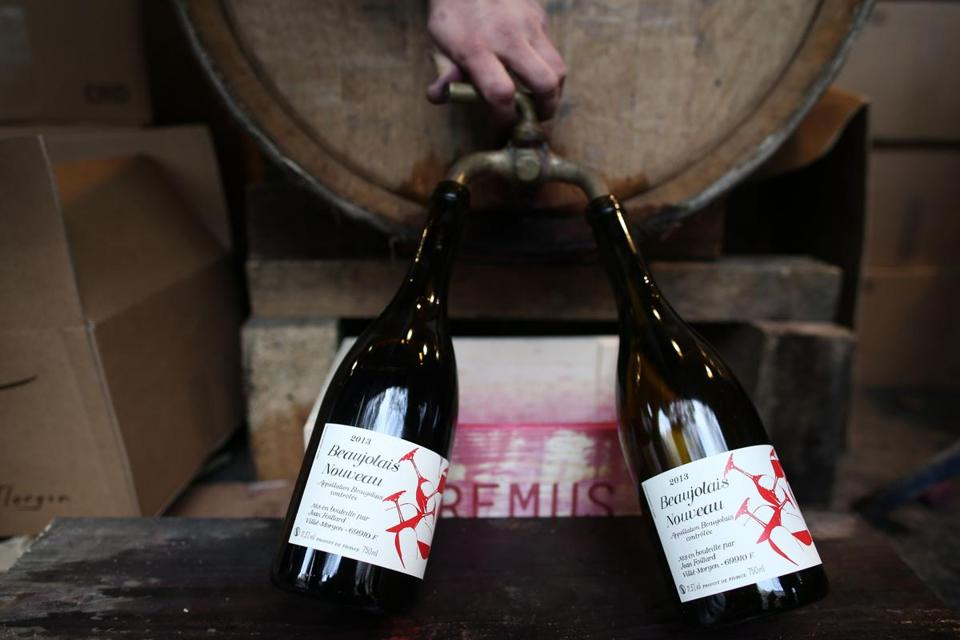 Wine growers bottled wine last week during the traditional Beaujolais Nouveau 2013 edition in Paris.