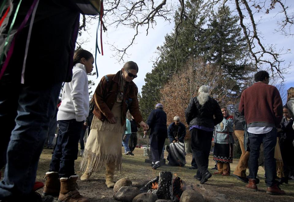 Mashpee Wampanoag tribe members sprinkled tobacco over a fire at a Thanksgiving celebration.