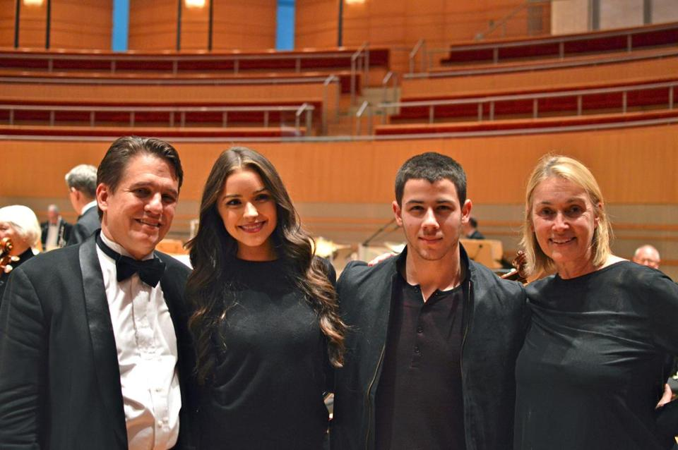 Boston Pops conductor Keith Lockhart and violist Susan Culpo took a photo with her daughter,  Miss Universe 2012 Olivia Culpo, and her boyfriend Nick Jonas.