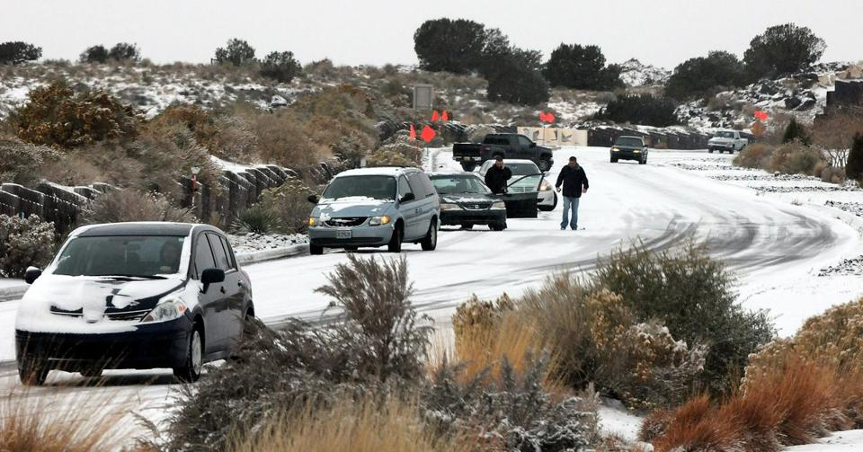 Near white-out conditions were reported around Albuquerque Sunday, leading to difficult driving in the desert. Flagstaff, Ariz., had 11 inches of snow.