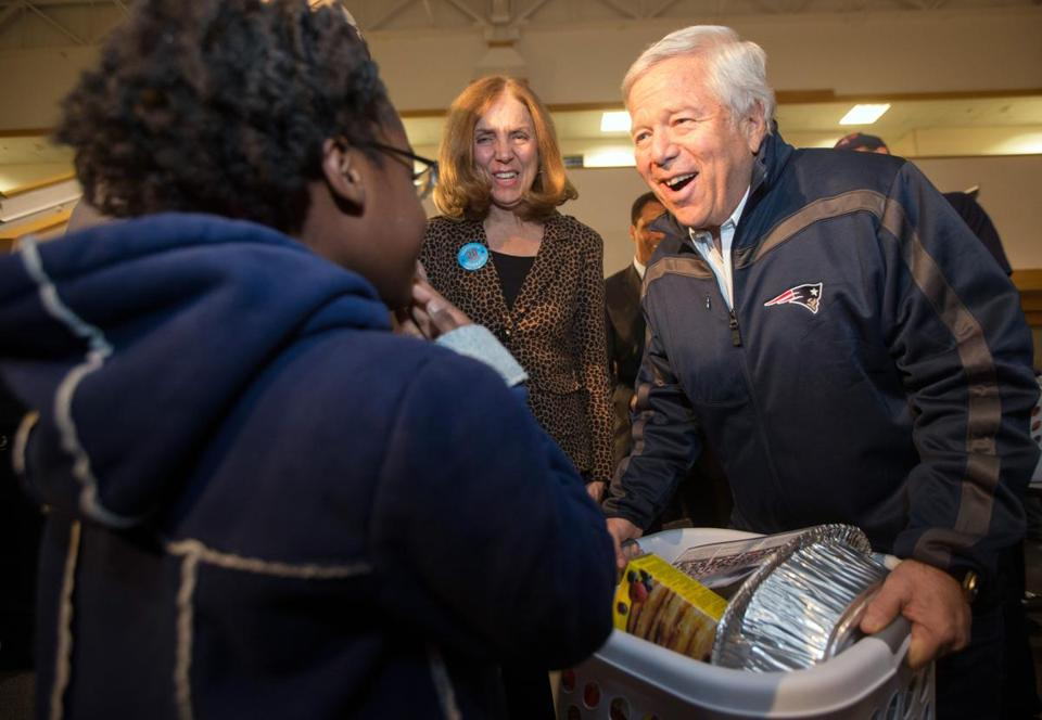 Goodwill's Joanne Hilferty and Robert Kraft hand out turkeys at the Goodwill headquarters.