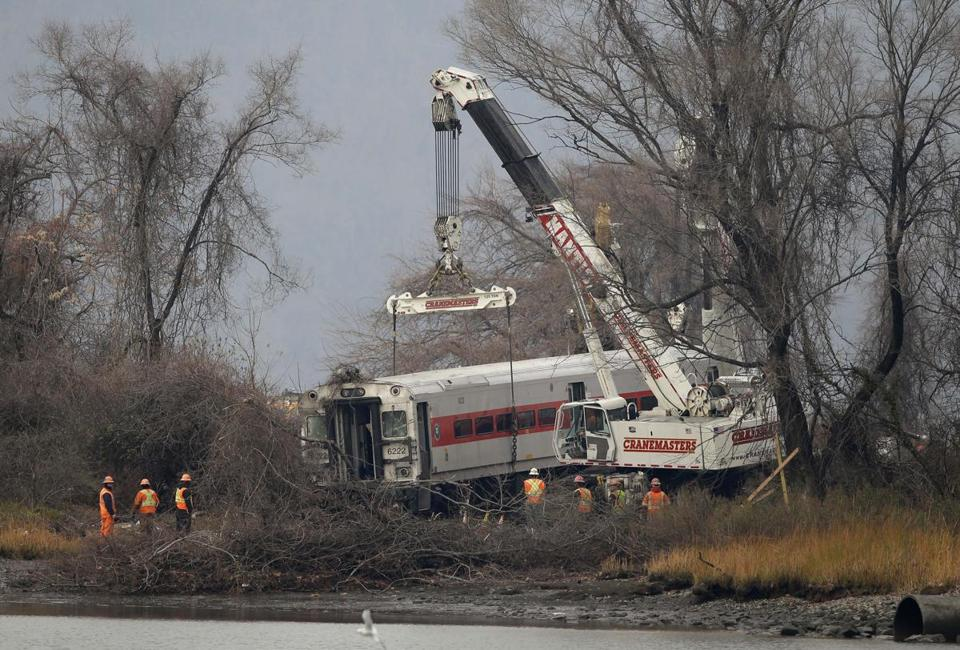 Cranes on Monday removed the last car from a train derailment in the Bronx that killed four passengers the day before.