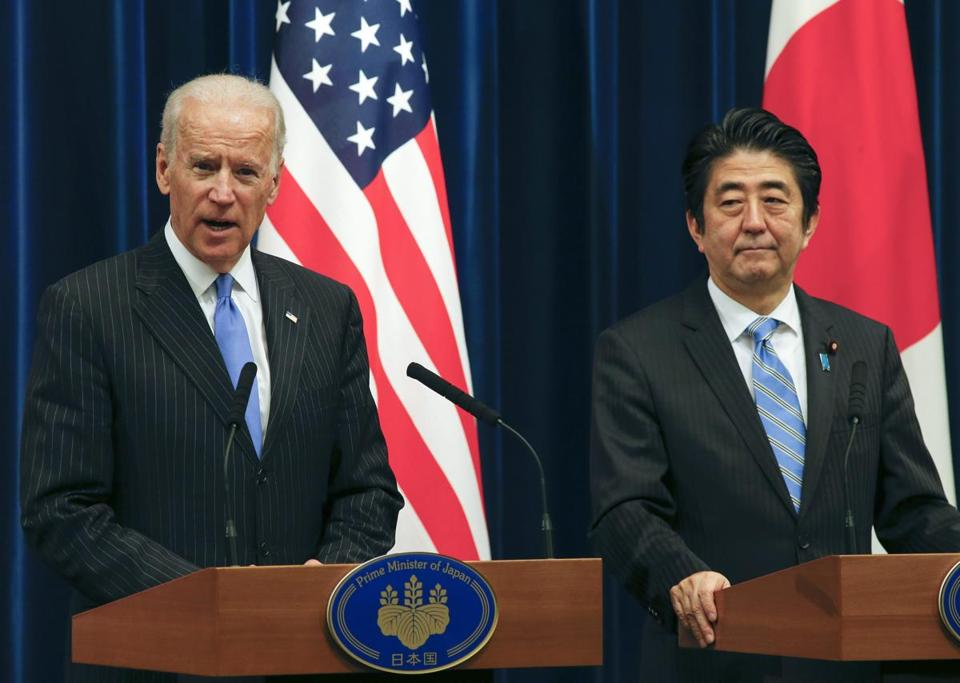 US Vice President Joe Biden (left) spoke at a press conference with Japanese Prime Minister Shinzo Abe in Tokyo.