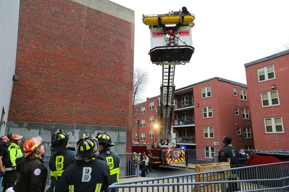 Firefighters Use Aerial Ladder To Rescue Man From Roof