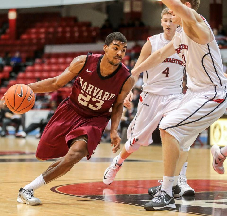 Harvard's Wesley Saunders drove to the hoop during Tuesday's game aginst Northeastern.