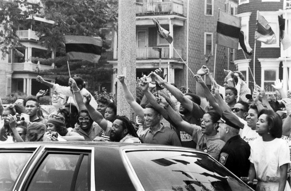 Well-wishers lined Martin Luther King Boulevard in 1990 as Nelson Mandela's motorcade left Madison Park High School in Roxbury.