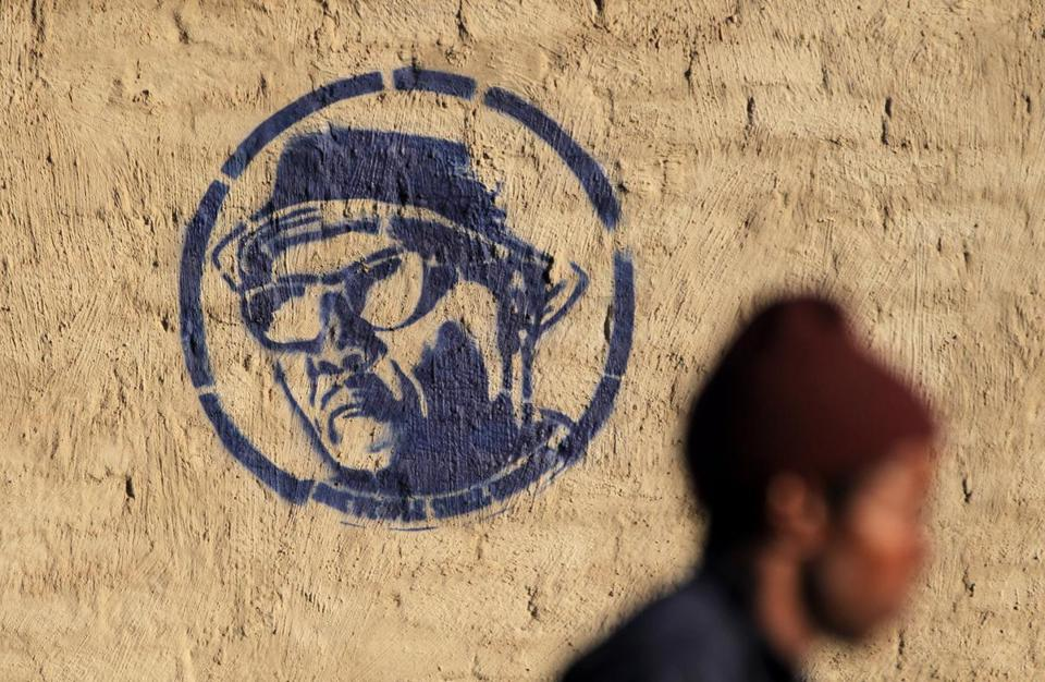 A stencil in Johannesburg depicts Nelson Mandela working in the Robben Island prison garden.