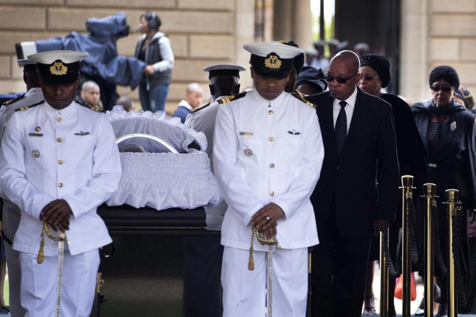 Mourners filed past the casket of former South African President Nelson Mandela at the Union Buildings in Pretoria, South Africa.