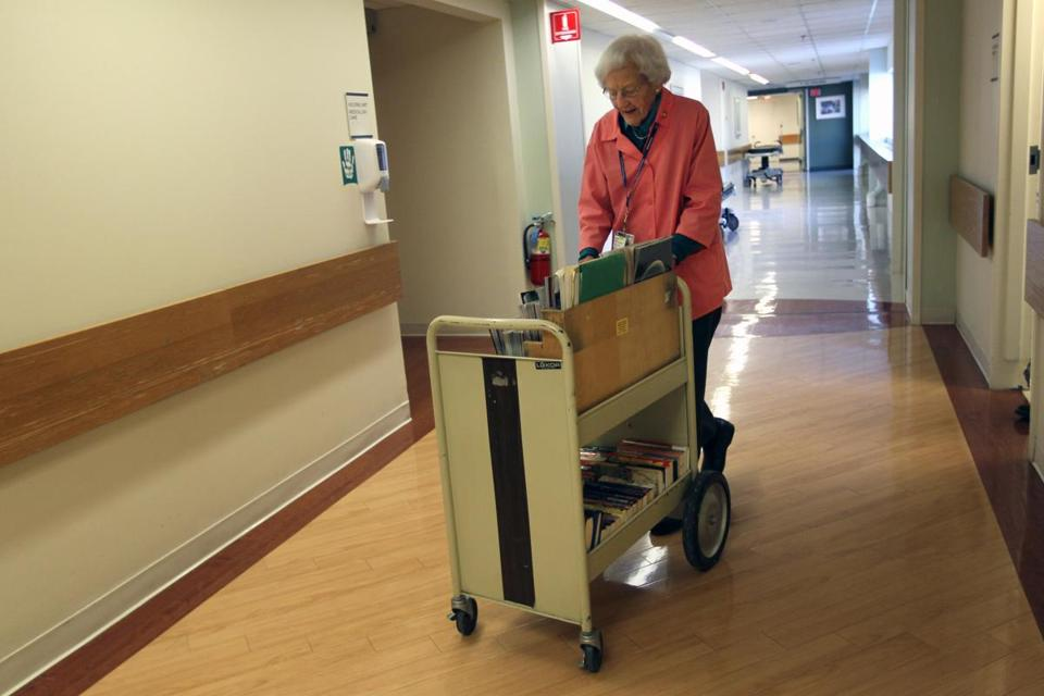 Ipswich's Hope Wigglesworth, 87, makes the rounds with her cart at Beverly Hospital.