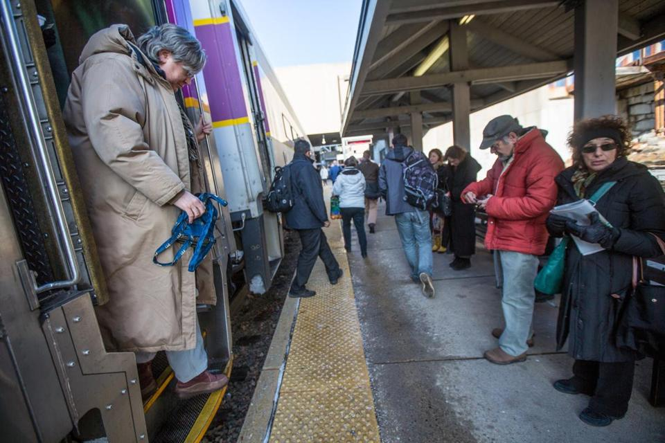 12/11/2013 CAMBRIDGE, MA Riders on the MBTA's Fitchburg/South Acton Commuter Rail line exit the train at Porter Square (cq). (Aram Boghosian for The Boston Globe)
