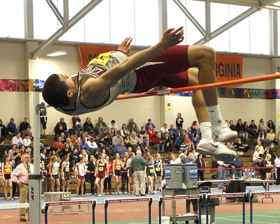 Lowell High's Gilberto Brown goes up and over to win the high jump at the Division 1 championships and later did the same at the All-State meet.