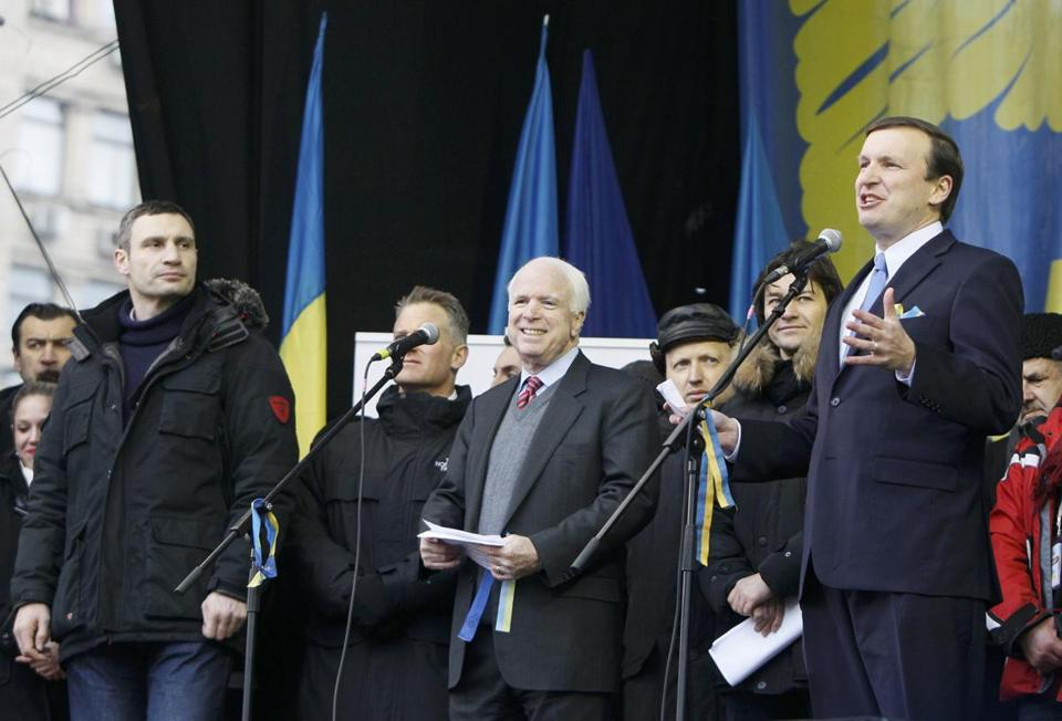 Senator Chris Murphy (right) delivered a speech as Senator John McCain (center) and Ukrainian opposition leader Vitaly Klitschko looked on during a rally in Kiev.