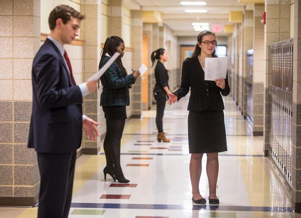 Alex Donovan  and Emma Foley (front) are among students practicing in the  hallway before the competitions.