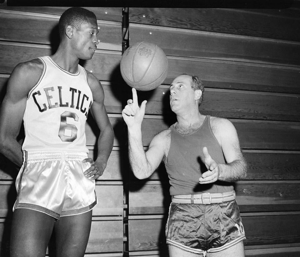 Word of mouth is what first tipped off Red Auerbach (right) to Bill Russell; that couldn't happen today. (AP Photo/J. Walter Green)