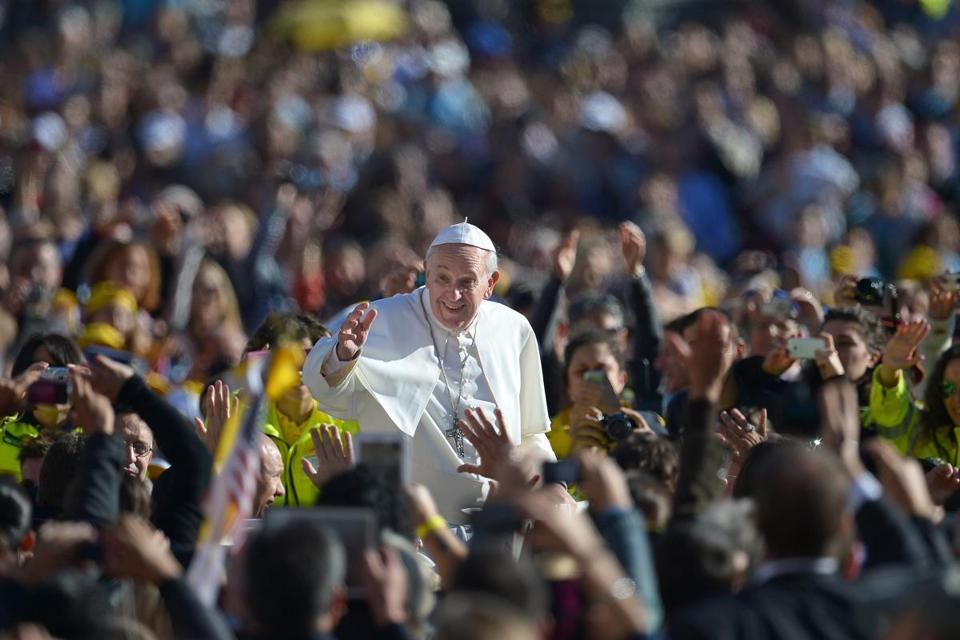 Pope Francis's words have resonated with many of the faithful since his election as pontiff. Here, Francis saluted the crowd as he arrived for his general audience in St Peter's Square on Nov. 6.