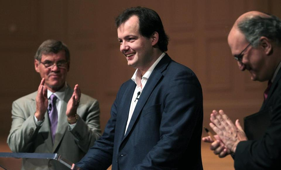 Andris Nelsons (center) with the BSO's board chairman Ted Kelly (left) and managing director Mark Volpe as Nelsons is introduced to BSO subscribers in June.