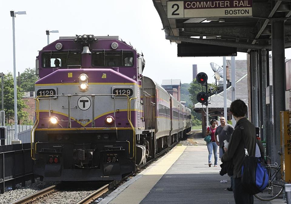 "A commuter rail train on the MBTA Worcester line. Police say travelers were delayed Saturday night after a man was spotted ""surfing"" on top of a Worcester-bound train while wearing a sombrero and a poncho."