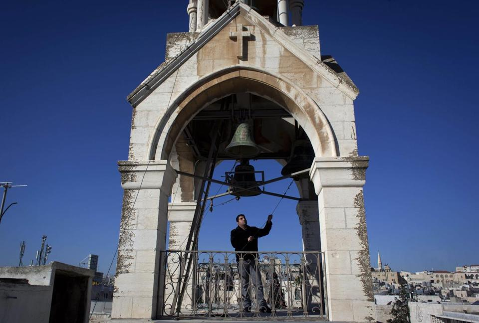 ''I feel like I'm making music and talking to God'' when ringing the bells at Church of the Nativity twice each week, says Khadir Jaraiseh, 22, During the Christmas season, his task is particularly enjoyable, he says.
