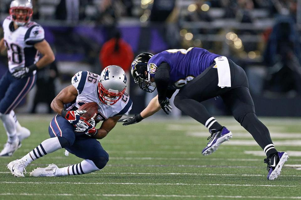 Patriots cornerback Logan Ryan picks off a third-quarter pass intended for the Ravens' Dennis Pitta, Ryan's second interception of the game.