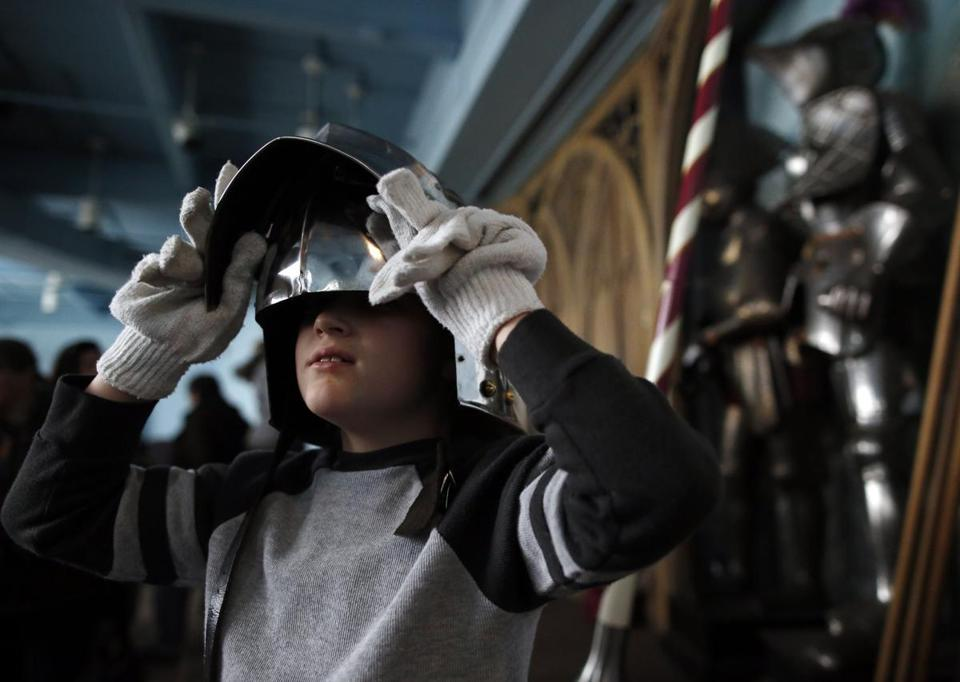 Jeremy Peters, 10, of Southbridge tried on a sallet as he and his family visited the Higgins Armory Museum earlier this month.