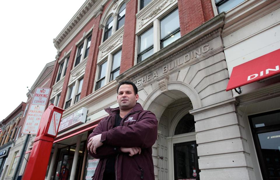 Dan Bandar in front of the O'Shea building at 9 Main St. Dan and his brother Hany plan to spend $10 million to build a new hotel.
