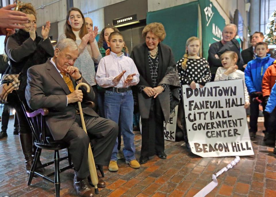 Mayor Thomas Menino, his wife Angela (right), and his grandson Thomas Menino III were greeted by Boston students.
