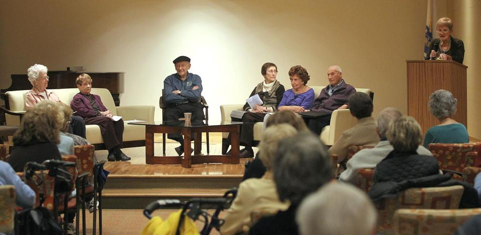 Lorraine Greenfield (right) addresses an audience with memoir writers (from left) Mimi Cerier, Nancy Parritz, Charles Hersch, Fay Bussgang, Dotty Tobin Sacks, and Irving Bachman.