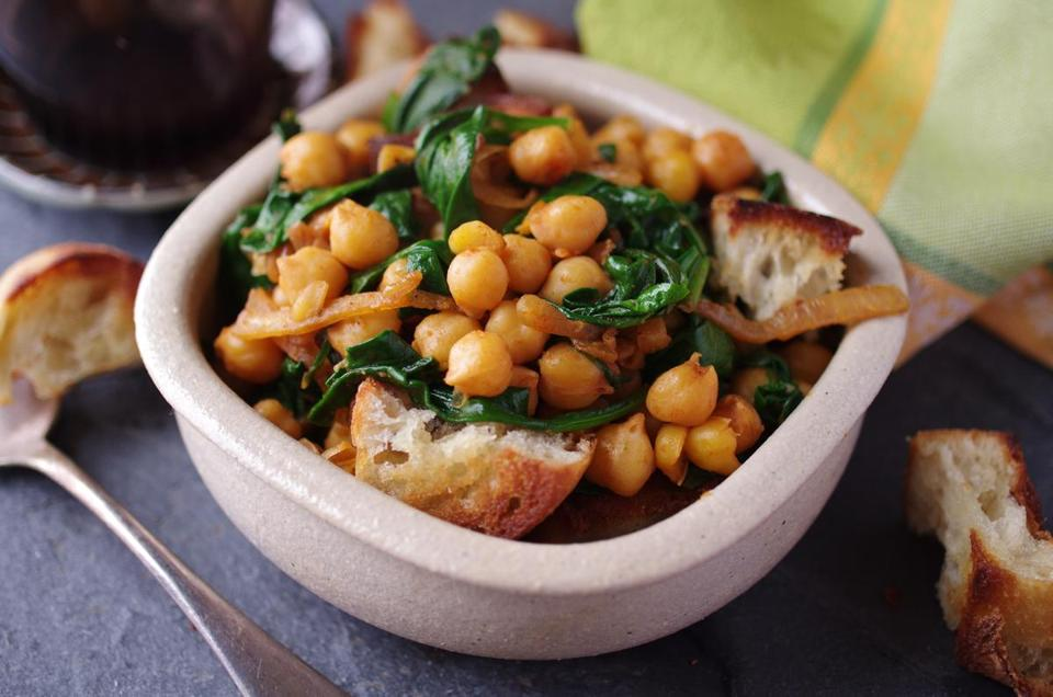 Spanish smoked-paprika chickpeas (the protein- and fiber-rich legume native to the Middle East) with spinach.