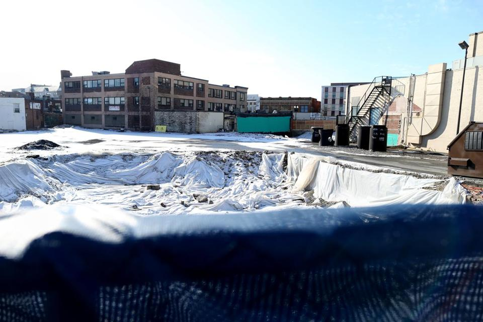 For now, construction has come to a halt on the Merchants Row project in Quincy.
