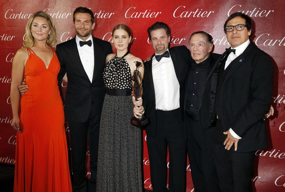 "Some ""American Hustle"" winners in Palm Springs, Calif. (from left): Elizabeth Rohm, Bradley Cooper, Amy Adams, Shea Whigham, Paul Herman, and director David O. Russell."